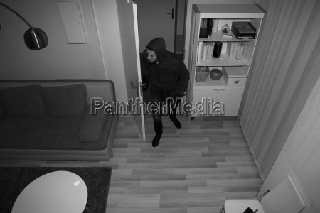 robber, entering, in, house - 23603538
