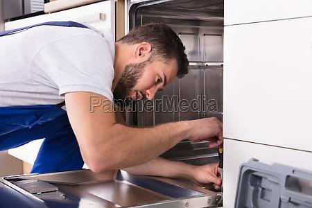 technician, repairing, dishwasher - 23603468