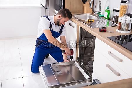 technician, repairing, dishwasher - 23603474