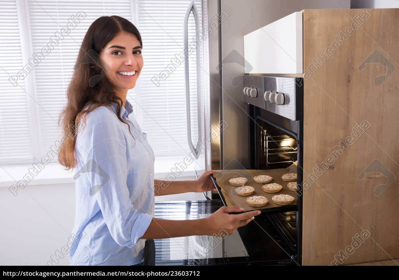 woman, baking, cookies, in, microwave, oven - 23603712