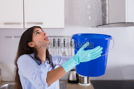 woman, holding, bucket, while, water, droplets - 23603680