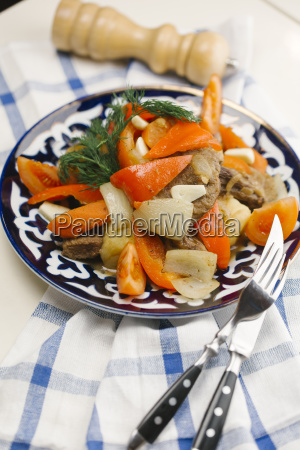 meat and vegetables on plate with
