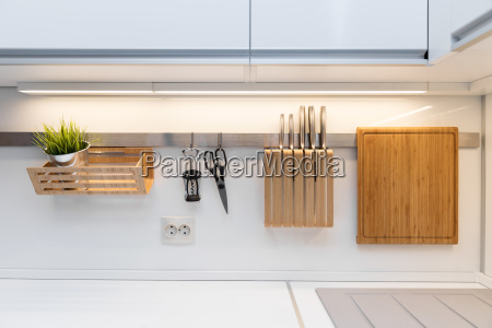 kitchenware hanging on the rail in