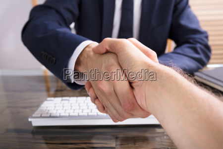 businessman, shaking, hand, with, his, partner - 23610376