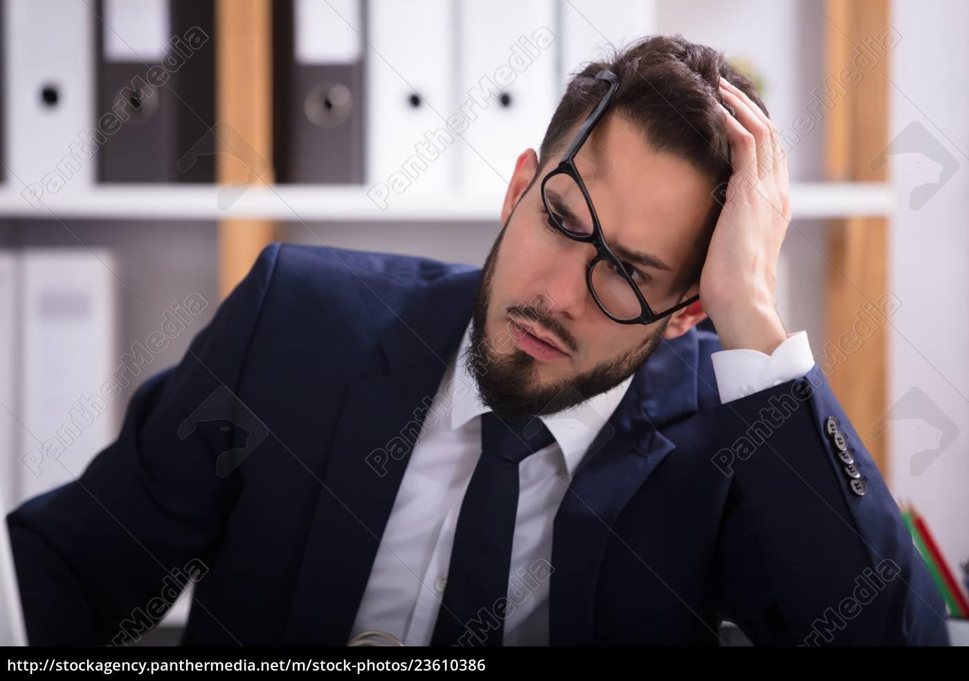 close-up, of, a, sad, businessman - 23610386
