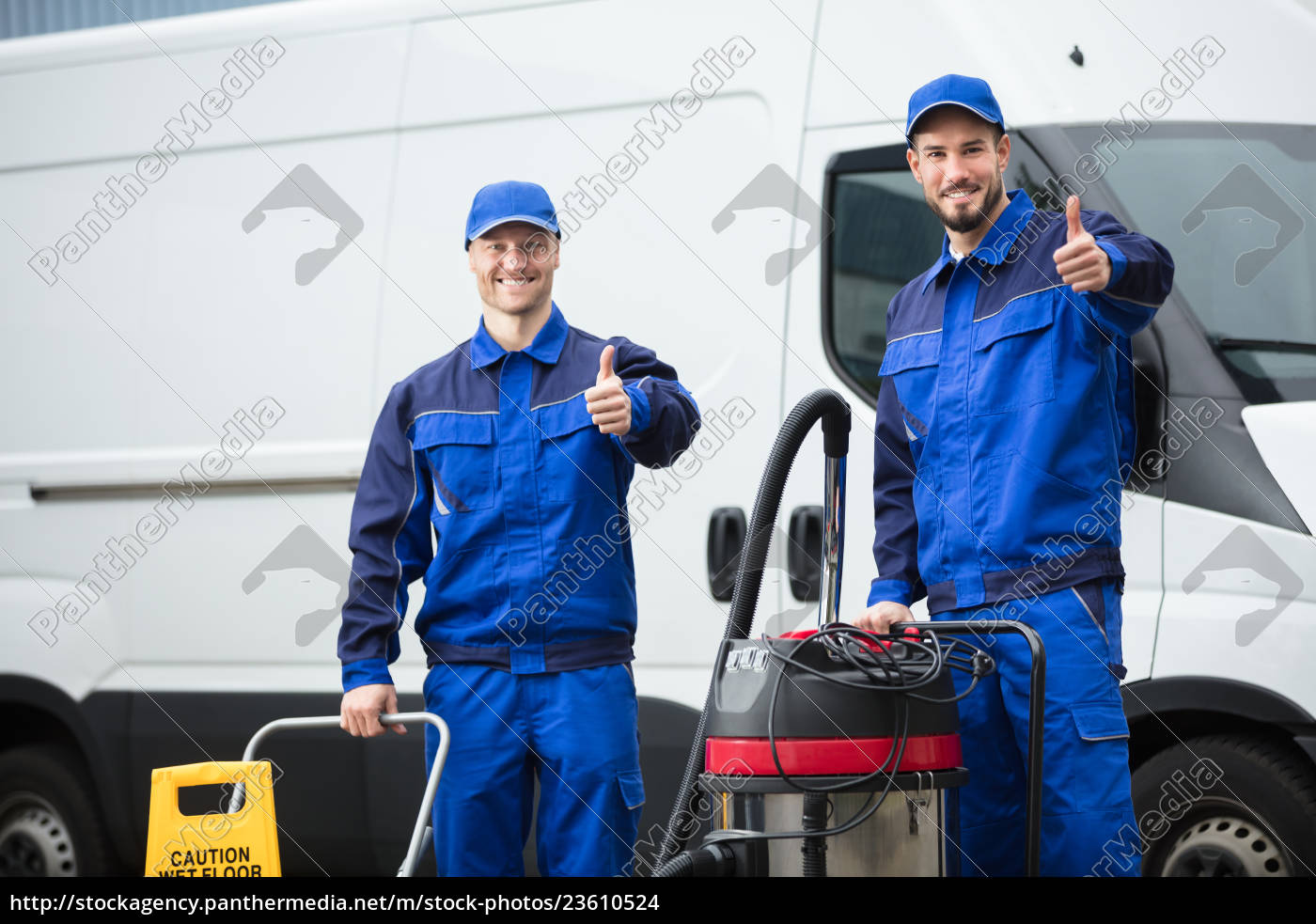 portrait, of, two, happy, male, janitors - 23610524