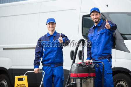 portrait, of, two, happy, male, janitors - 23610524