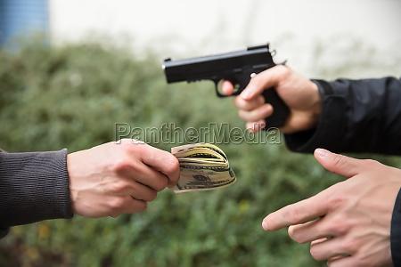 robber, with, gun, threatening, someone, to - 23610532