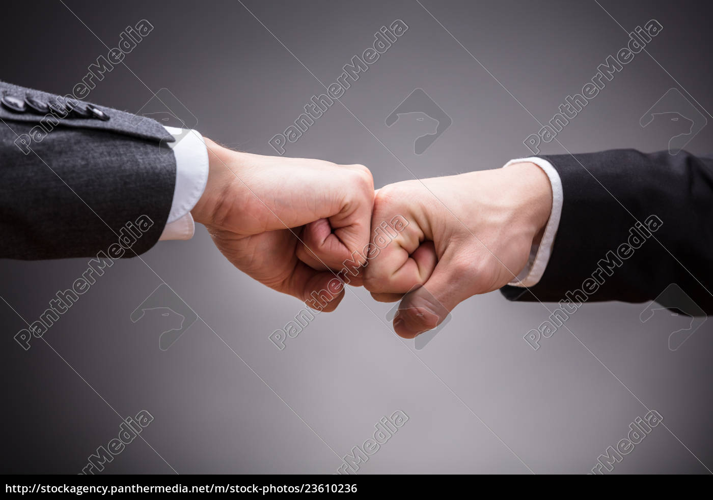 two, businesspeople, making, fist, bump - 23610236