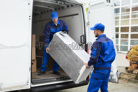 two, delivery, men, unloading, furniture, from - 23610662