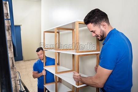 two, men, carrying, shelf - 23610574