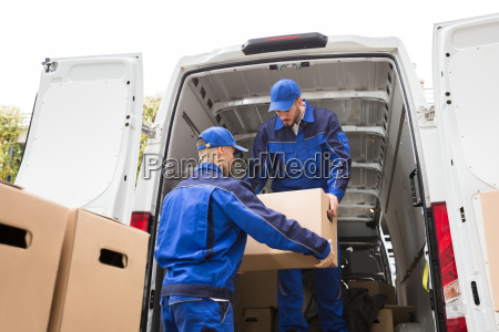 two, movers, carrying, cardboard, box - 23610670