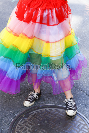 person wearing rainbow skirt