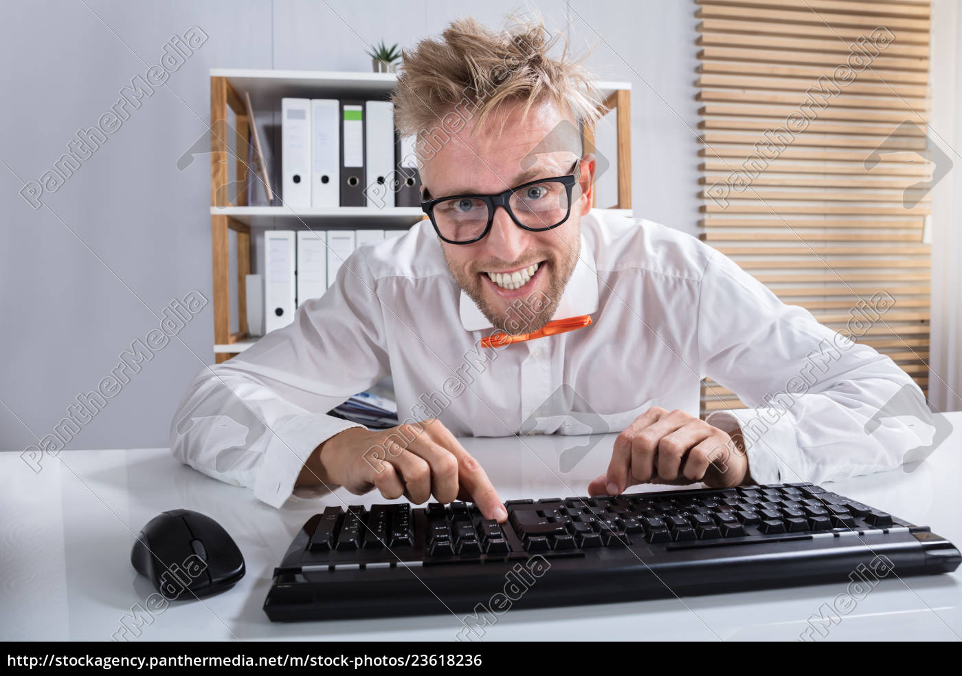 businessman, in, orange, bow, typing, on - 23618236
