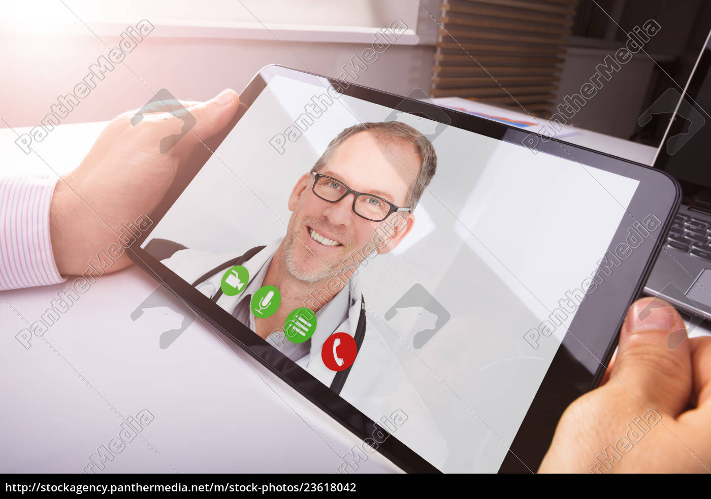 businessman, video, conferencing, with, doctor - 23618042