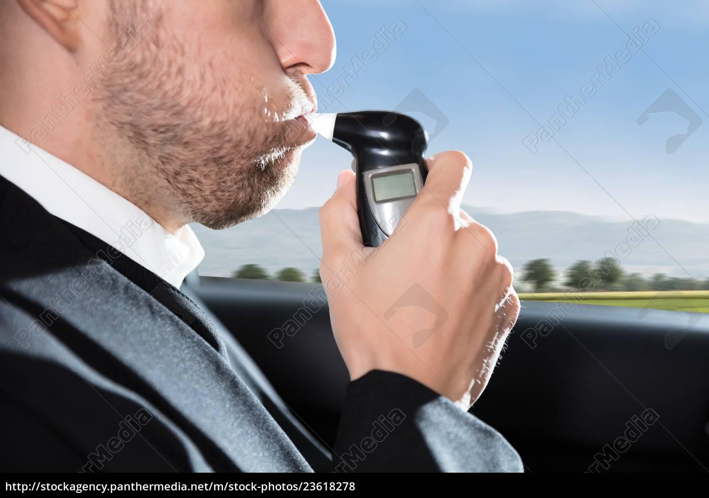 man, taking, alcohol, test - 23618278
