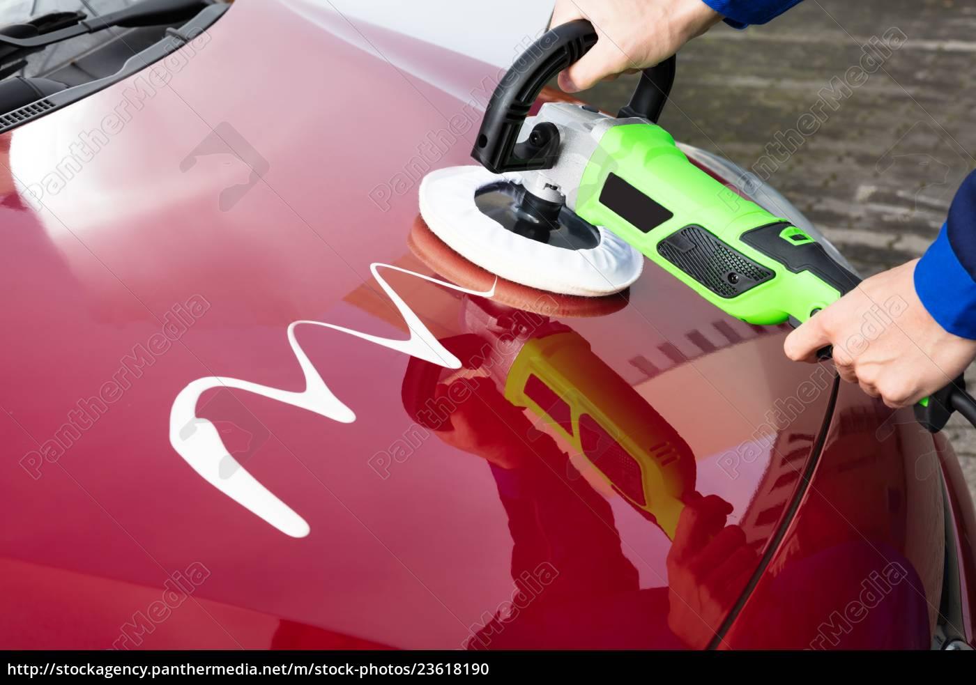 person's, hand, polishing, car, hood - 23618190