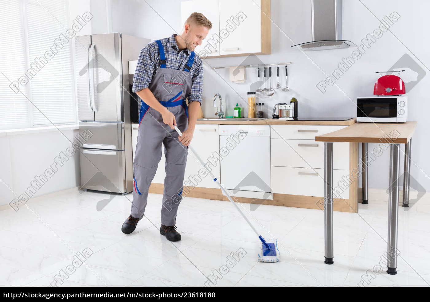 young, male, worker, mopping, floor - 23618180
