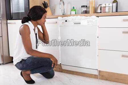 woman looking at foam coming out