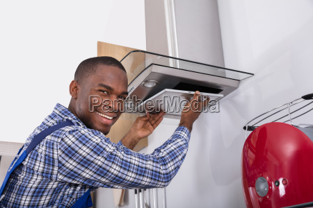 african, male, fixing, kitchen, extractor, filter - 23620276