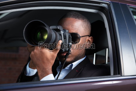 detective, sitting, inside, car, photographing - 23620324