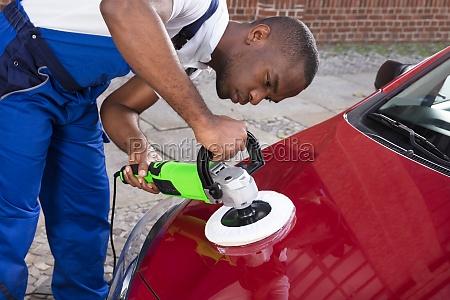 hands, polishing, car, with, orbital, polisher - 23620312