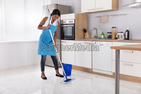 housewife, cleaning, floor, with, mop - 23620464