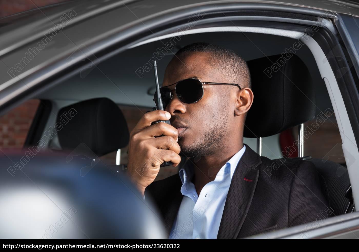 man, sitting, inside, car, talking, on - 23620322