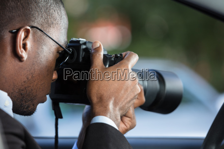 private, detective, sitting, inside, car, photographing - 23620326