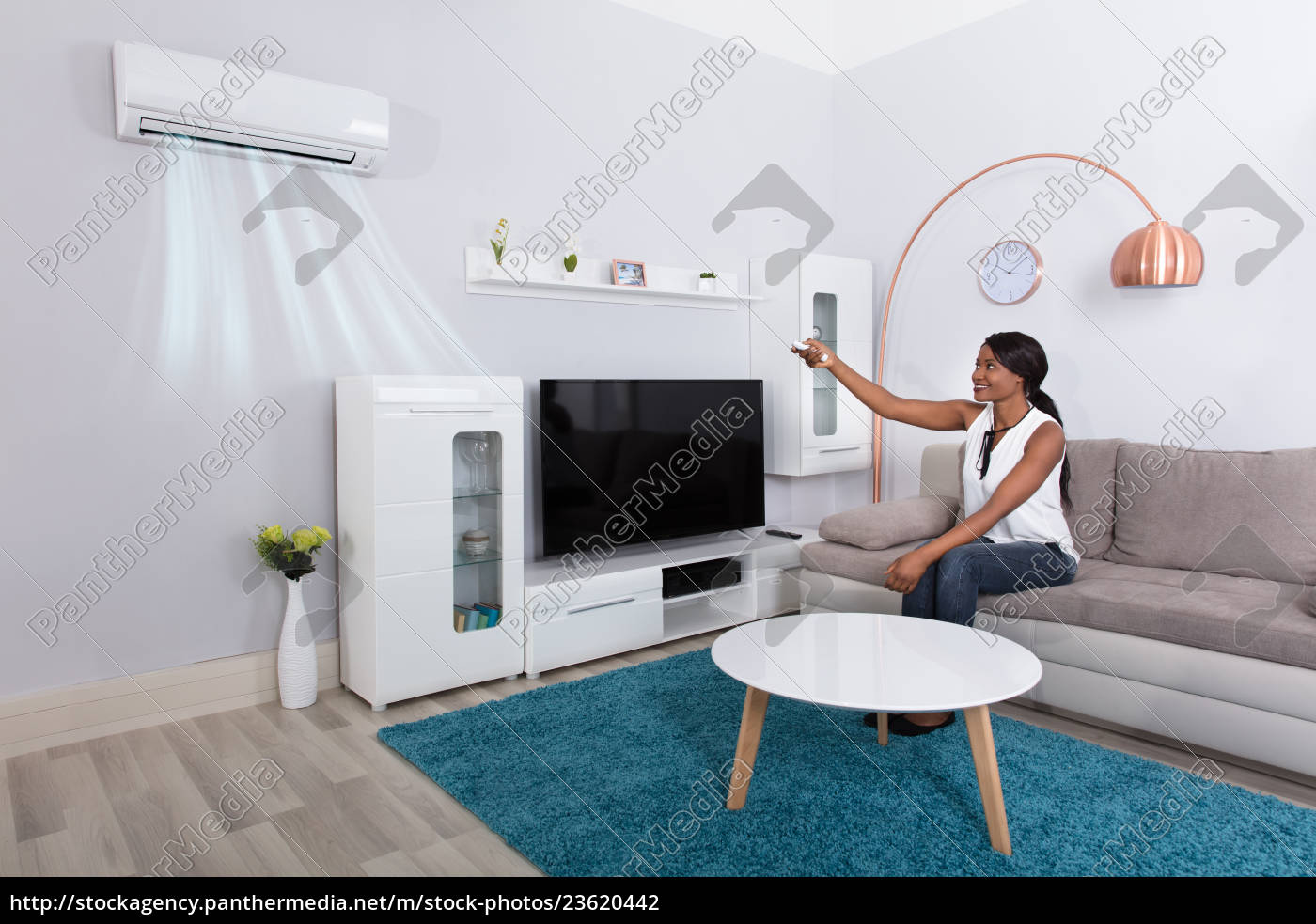 woman, using, air, conditioner, at, home - 23620442