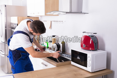 electrician repairing induction stove
