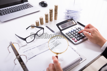 businesswoman, checking, invoice, with, magnifying, glass - 23624290