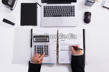 businesswoman, hand, calculating, invoice, using, calculator - 23624288