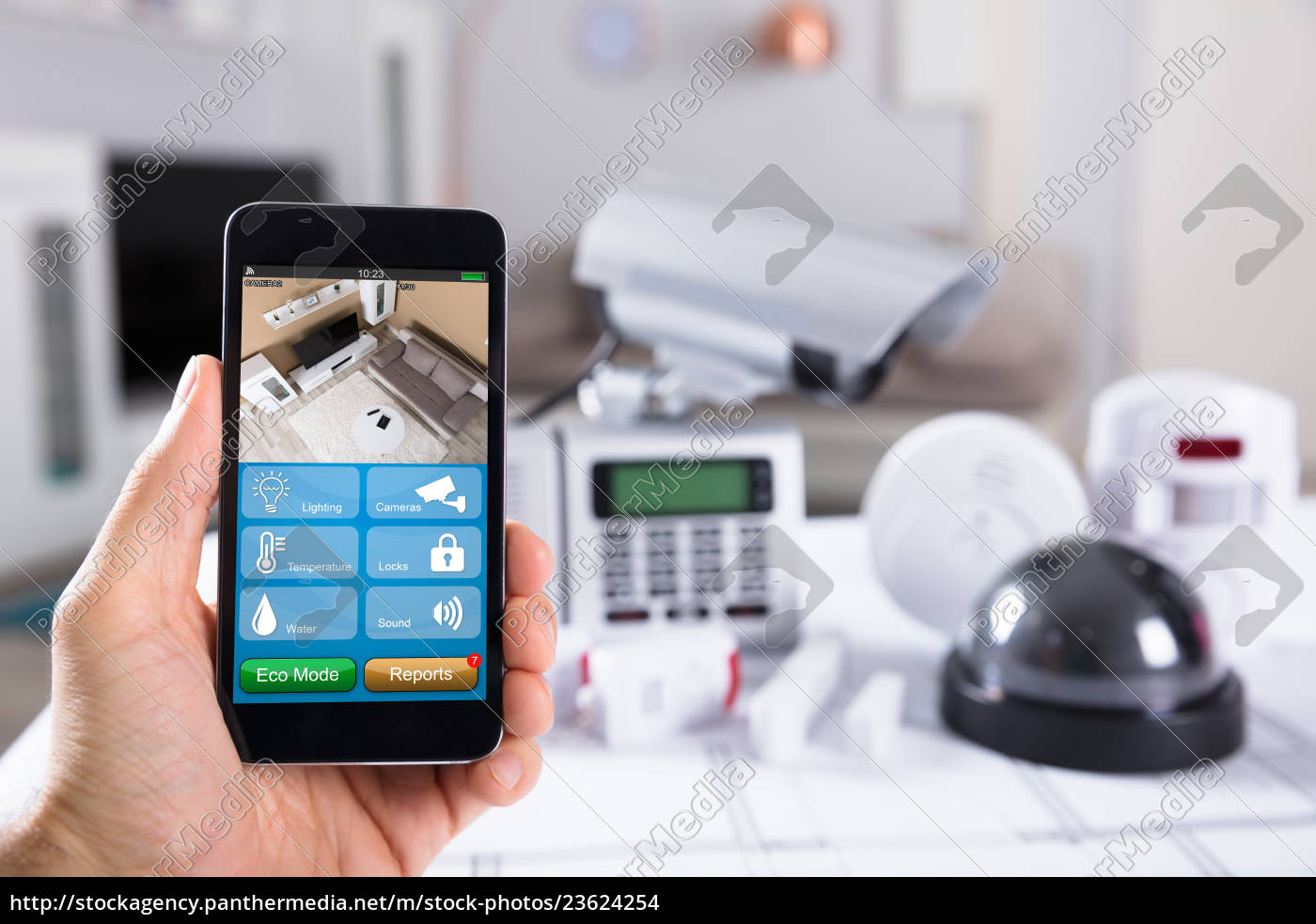 person, holding, mobile, phone, with, cctv - 23624254
