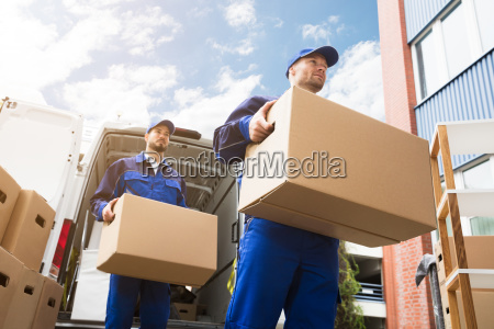 close up of two delivery men