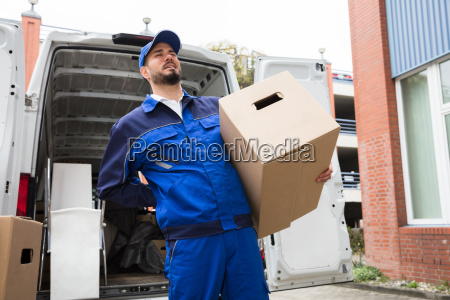 male worker carrying suffering from backpain