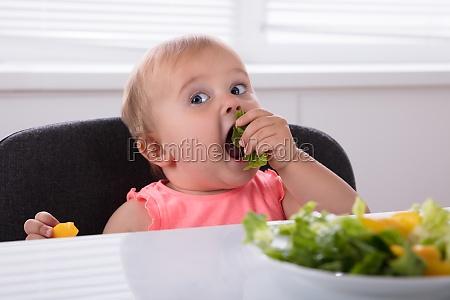 baby girl eating healthy food