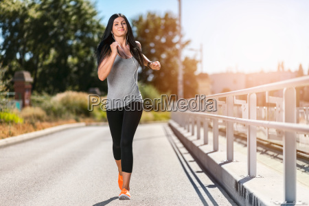 city workout beautiful woman running in