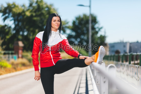 city workout beautiful woman training in