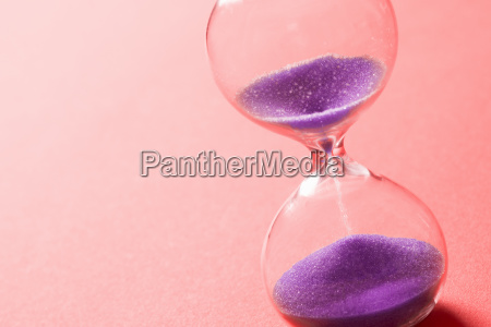 purple sand clock hourglass