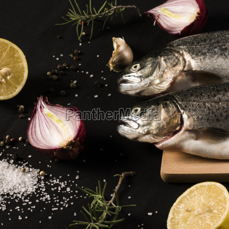 raw trout fish with ingredients