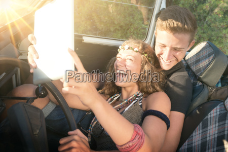 couple in a car at sunset
