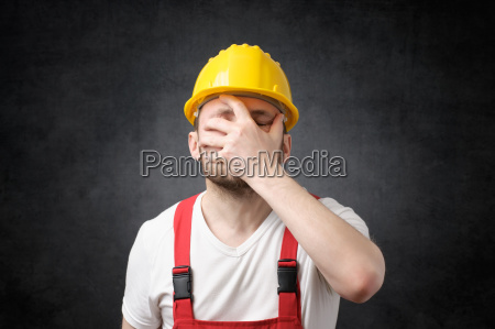 disappointed construction worker