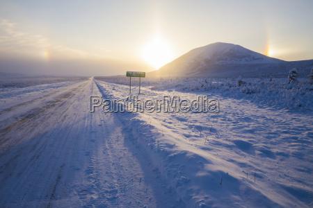 parhelia sundogs surround the sun and