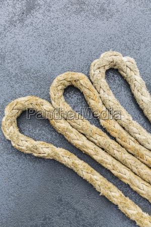 large gauge marine ropes coiled on