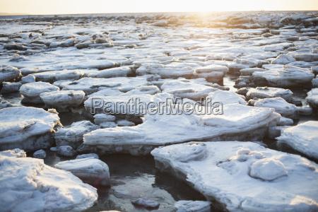 ice chunks on a beach in