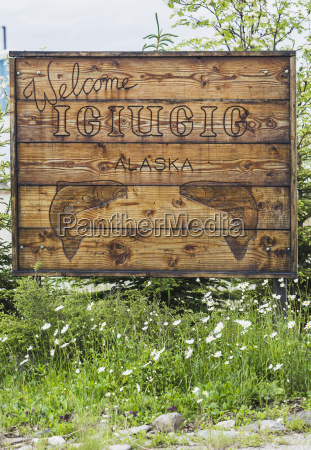a wooden sign with two carved