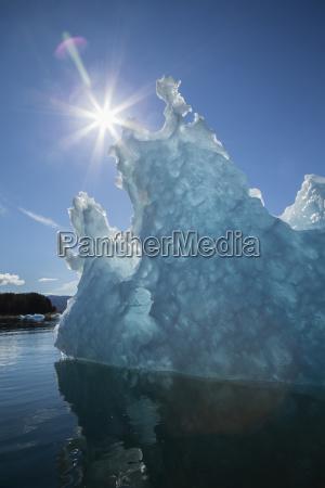 an iceberg glows in the late