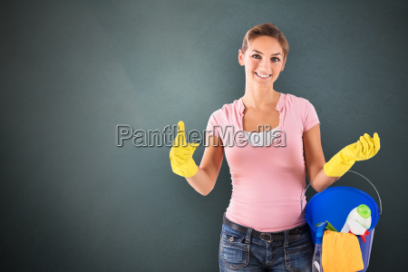 female janitor gesturing thumbs up