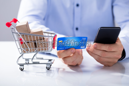 man use credit card for shopping